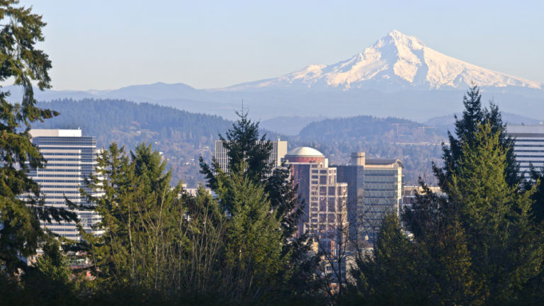 Mt. Hood panorama and downtown Portland Oregon buildings. Shutterstock